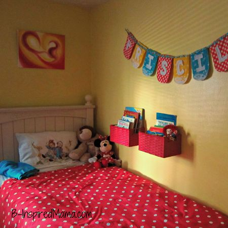 A colorful red and yellow girls room with fun handmade, vintage and thrift store finds at B-InspiredMama.com.