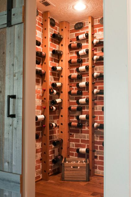 transitional wine cellar by Angela Flournoy Love this idea for storing wine...simple to do and you can see the labels when looking for a particular bottle.  Brilliant.