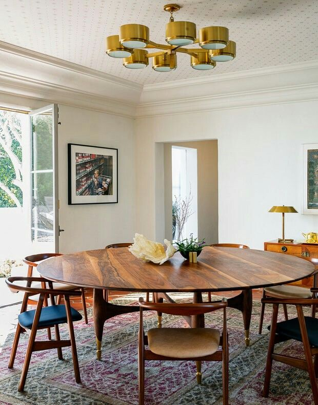 Gorgeous large round dining table with rehopolstered midcentury modern dining chairs