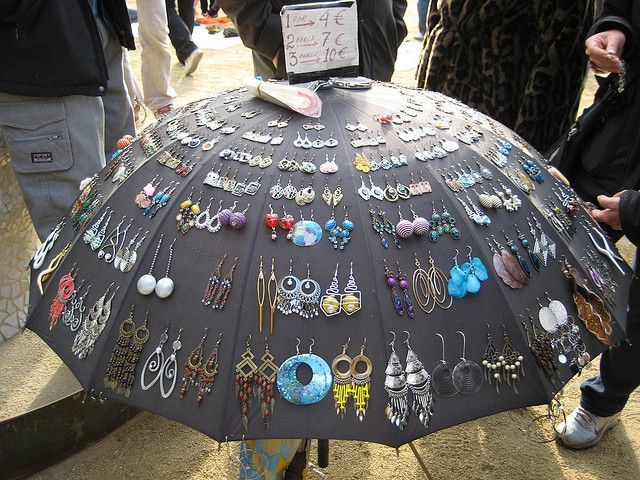 Earrings stuck through an umbrella for display