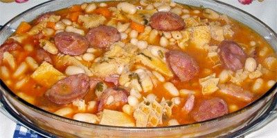 Dobrada: Classic Portuguese recipe for a stew of tripe and chickpeas cooked in a parsley and tomato base with hot chorizo (chourico) sausage...