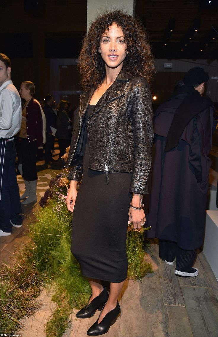 All eyes on her: Noemie Lenoir put on a stylish display in an all-black ensemble...