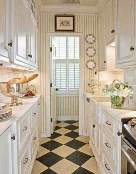 Cute Little Galley Kitchen With Pinstriped Wallpaper And Checkered Floor