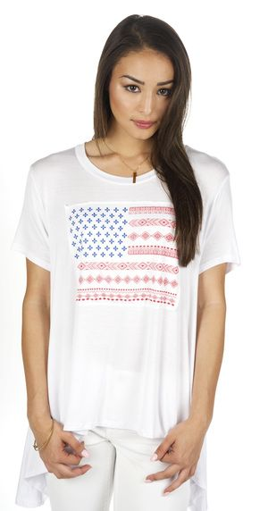 OH SAY PATCH TEE: Outfitted with a Patched On American Flag, this luxuriously soft tee will have her pledging allegiance to the flag…of sunny beaches and awesome waves. She can wear this with her favorite shorts all summer long. Oh did we mention this Tee was (MADE IN THE USA) even that much more patriotic!