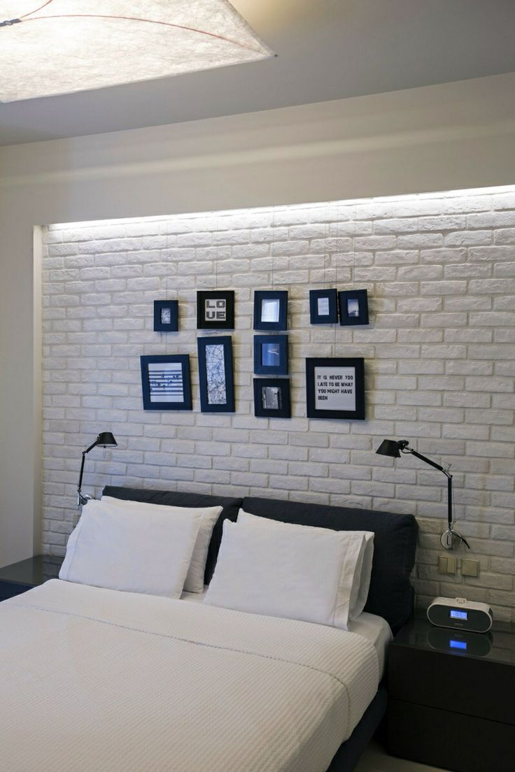 Elements: False Ceiling with Light, White Bedding, Hanging Frame Collage
