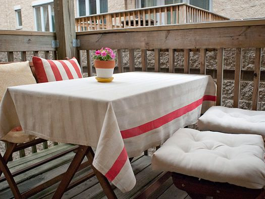 A DIY your outdoor tablecloth! I love the subtle stripes and splash of red. If you want to try it out, here's the link: http://www.yellowbrickhome.com/2011/05/24/ill-do-it-myself-tablecloth/