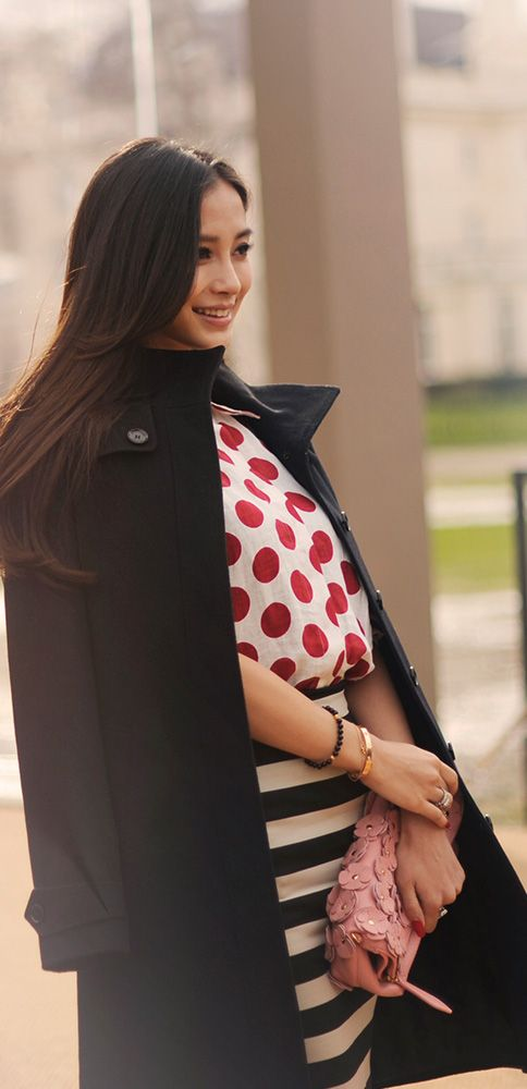 Chinese actress Angelababy wearing S/S14 dots and stripes as she arrives at the Burberry A/W14 show space in London's Kensington Gardens
