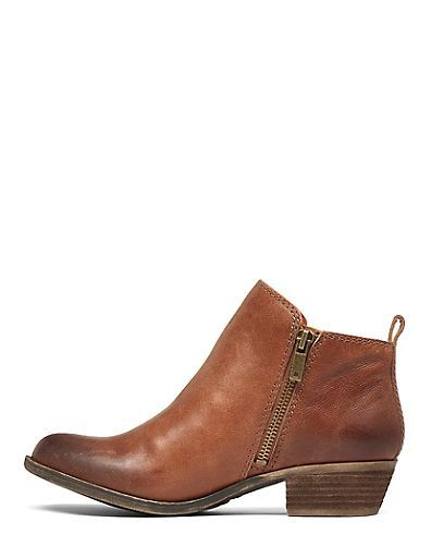 Western-inspired booties crafted from premium leather and finished with zipper detailing.<br/><br/>• 1.1 inch stacked heel<br/>• Leather upper, microsuede lining, rubber outsole