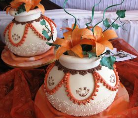This set of three pots with flowers, few twigs and ivy leaves and resting on the sugarcraft cloth as well, were made for a bride who wanted ...