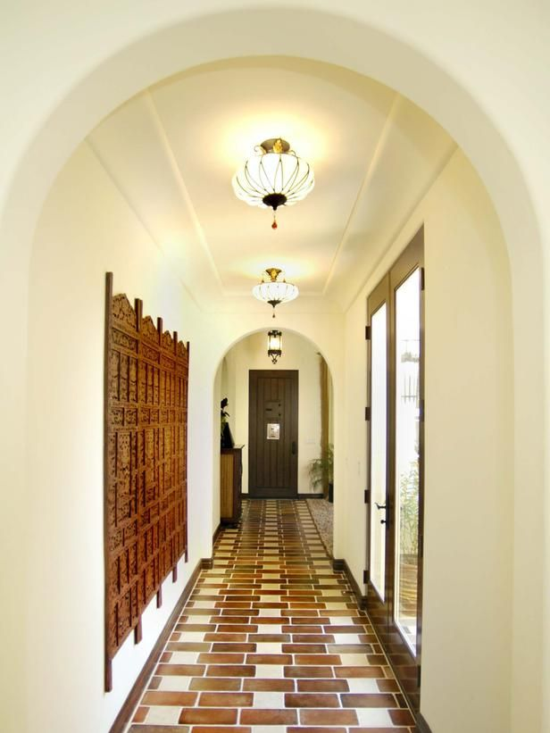 The Tile Floor Pattern Creates A Pathway From Homes Entrance To Interior Courtyard