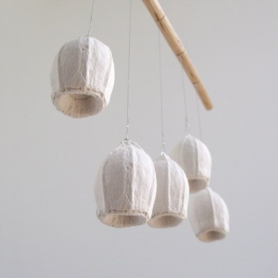 White gumnut wall hanging. A cast plaster seedpod mobile handmade in Australia by Kuberstore