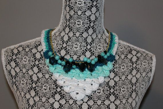 Hand made crocodile stitch crochet bib necklace in mint & white thread attached to a gold tone curb chain that fastens at the back with a
