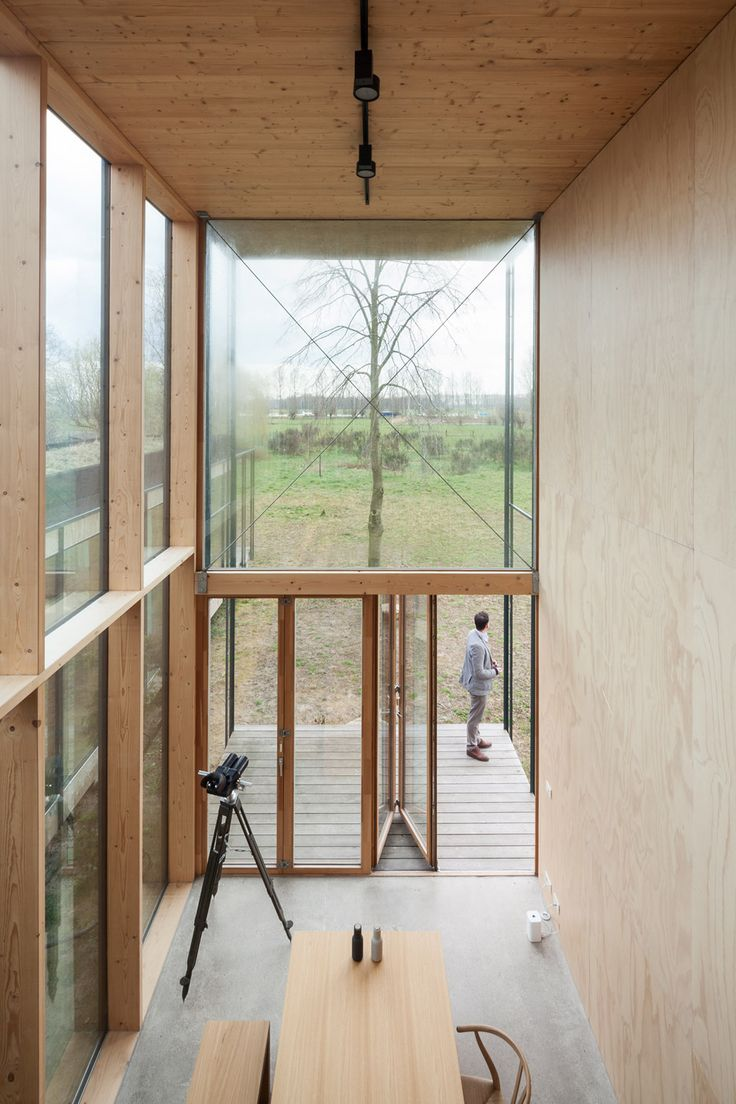 Belgian holiday house featuring plywood walls and a structure of repeated metal profiles