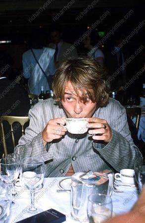 Mark Owen, British singer, drinking tea at the Silver Clef Awards, London, 1995. Photo by Richard Young.