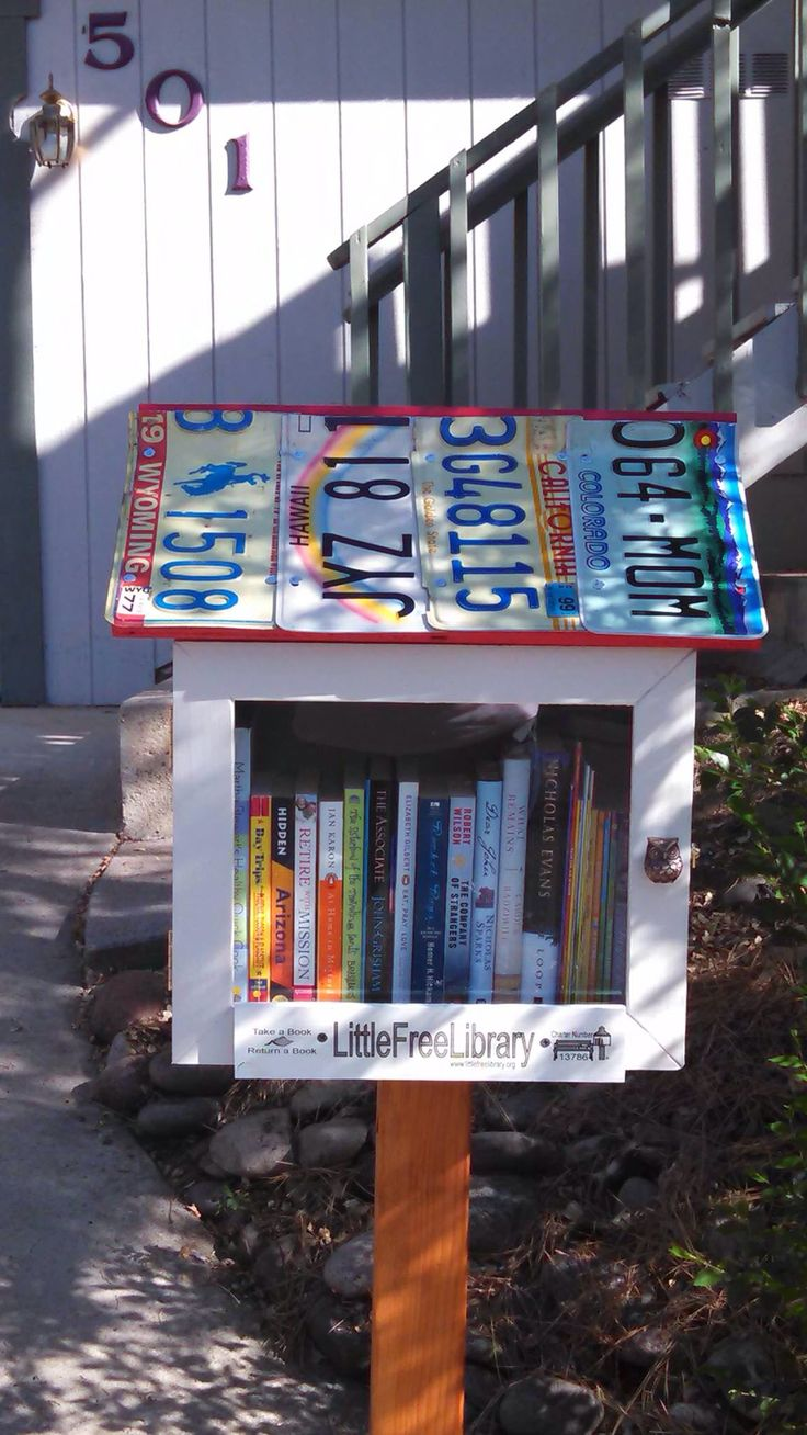 License plate covered Little Free Library