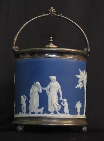 "A Victorian Wedgwood cobalt blue jasperware cookie jar with lid.  Stamped Wedgwood & England. 1890s. Height: 17.7 cm ( 7"")"