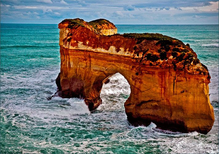 """This magnificent arch is among the many unusual features along the """"Great Ocean Road'. This rates among the tn best drrives in the world, The Great Ocean Road abounds with many magnificent features such as this.    #melbourne  #australia"""