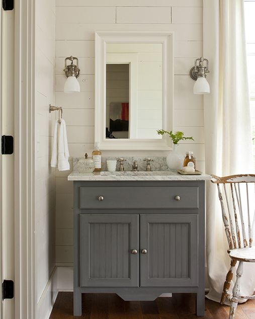 Southern Living - grey bathroom vanity, marble countertop, white framed mirror. Not so matchy matchy with the white frame- I like it!