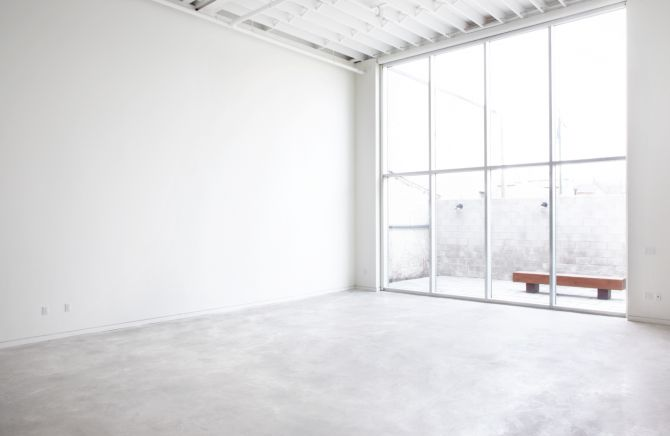 White Concrete floors (love this space and beautiful window light)