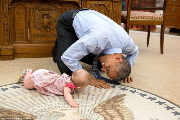 June 4, 2015. 'At the President's insistence, Deputy National Security Advisor Ben Rhodes brought his daughter Ella by for a visit. As she was crawling around the Oval Office, the President got down on his hands and knees to look her in the eye'