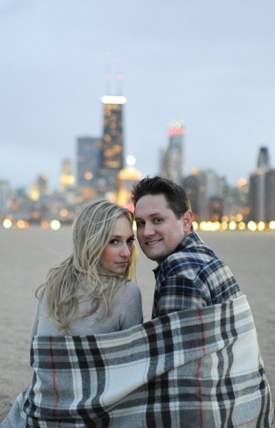 Blanket makes this urban engagement photo made so sweet, perfect accessory to keep you warm for a photo shoot or just because :: couples | engagement | outdoors | blanket
