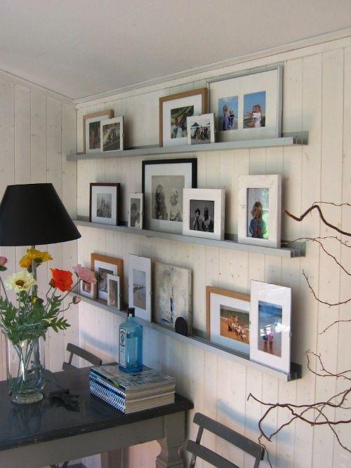 Fotolijstjes muur op rails, leuk!
