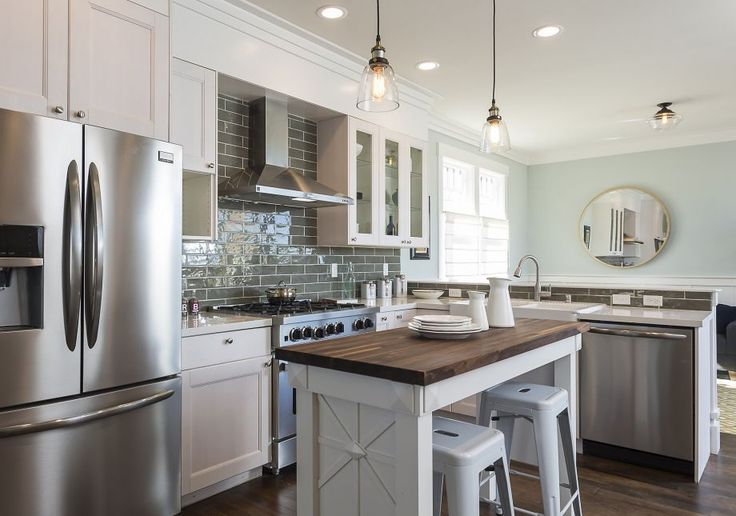 Display cabinets, stainless steel appliances and a subway tile backsplash accent the kitchen. Photo: Scott Hargis Photography