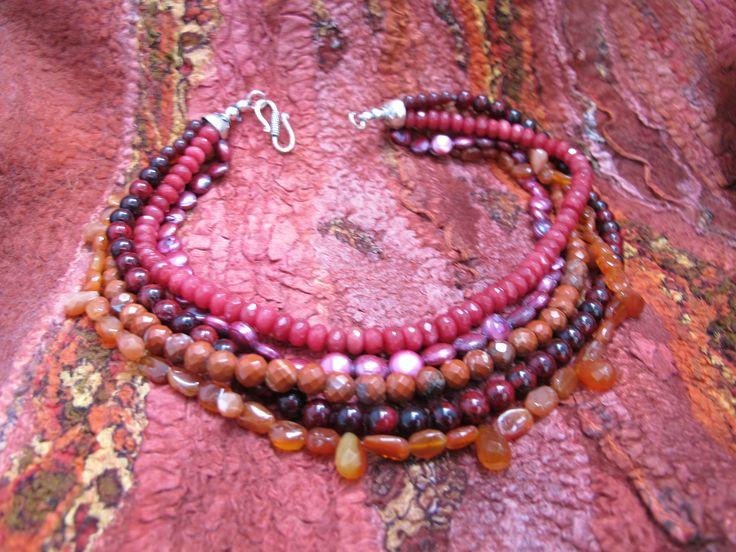 Quartz, ruby, jasper, carnelian necklace on Dorie van Dijk felted dress.  Sold at Artwear Jordaan.