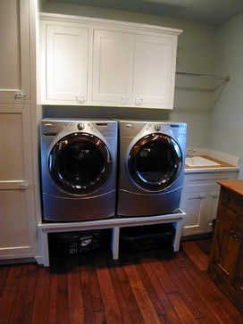 Put washer and dryer on risers so laundry baskets can be stored underneath