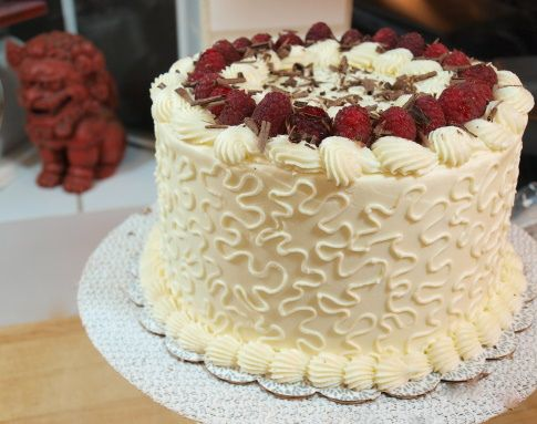 White chocolate cake with raspberry and chocolate ganache topped with white chocolate buttercream icing