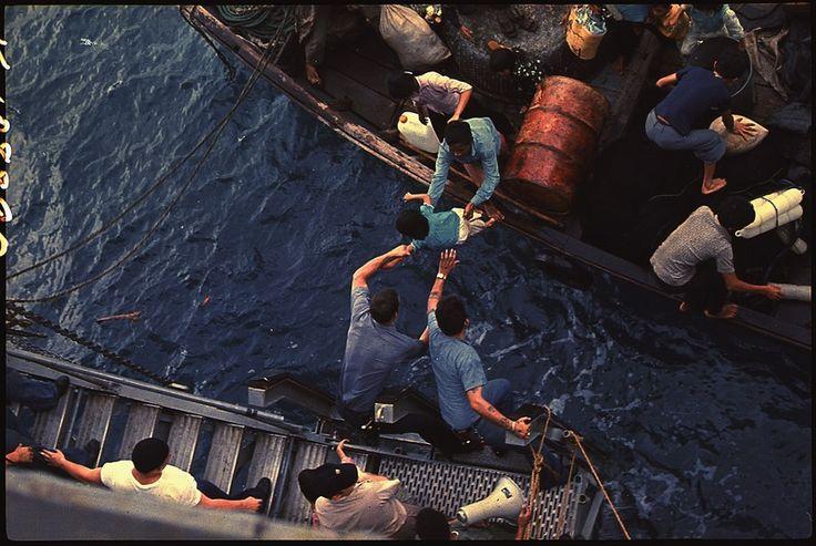 File:South China Sea....Crewmen of the amphibious cargo ship USS Durham (LKA-114) take Vietnamese refugees aboard a small... - NARA - 558518.tif
