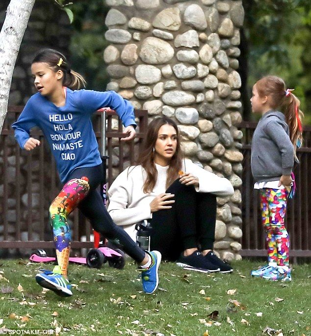 Girls' day! Daughters Honor and Haven Warren looked adorable in printed leggings, trainers and long-sleeve tops