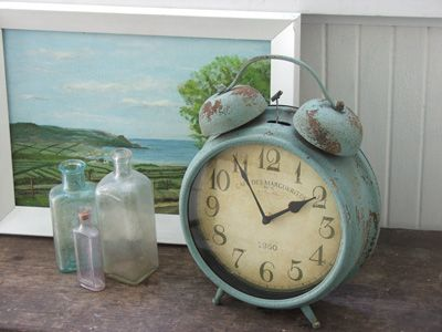vintage decor adds so much character to a room, love the rust on the clock