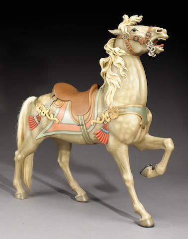 A carved and painted carousel horse