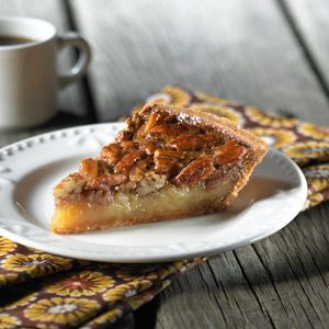 A classic pecan pie in this easy, crumb crust provides special-occasion flavor with home-style comfort.