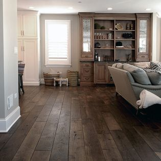 Barrington Residence - This Smoked Black Oak wide plank hardwood flooring, which is now being offered among our many collections, is a unique wood with many stunning features. These individual features, ranging from the deep and traditional color to the high level of work that goes into the creation of this product, differentiate it from much of the other flooring that is sold. As a result of the natural smoking process that the Oak undergoes, not only does the wood become more stable, but…