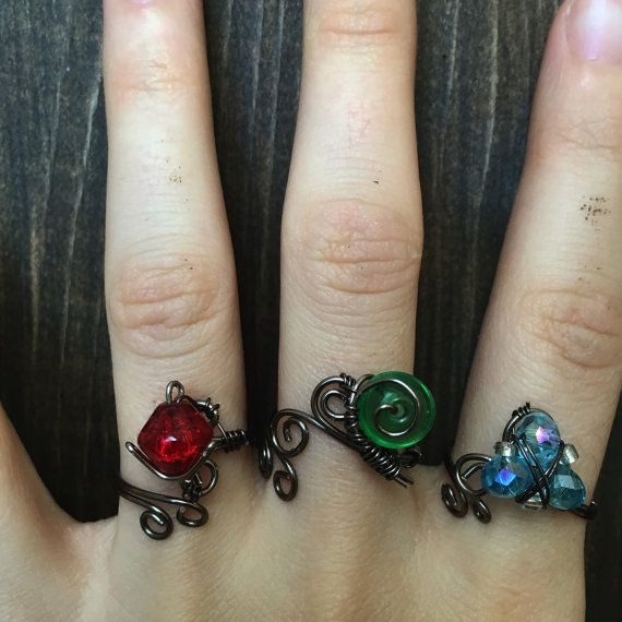 A three piece ring set inspired by the concept of dark link, and the spiritual stones from the legend of Zelda ocarina of time. They are