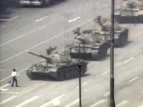 Tank Man (Wang Weilin?), standing in front of a column of Chinese tanks, Beijing's Tiananmen Square, June 5th, 1989