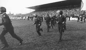 This image shows the police running out onto the field after anti-tour protestors broke through and managed to occupy the field, eventually leading to the cancellation of this match.