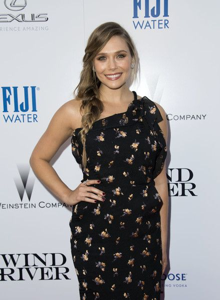 "Actress Elizabeth Olsen attends the Weinstein Company 'Wind River"" Los Angeles Premiere at the theater at Ace Hotel, on July 26, 2017, in Los Angeles, California. / AFP PHOTO / VALERIE MACON"