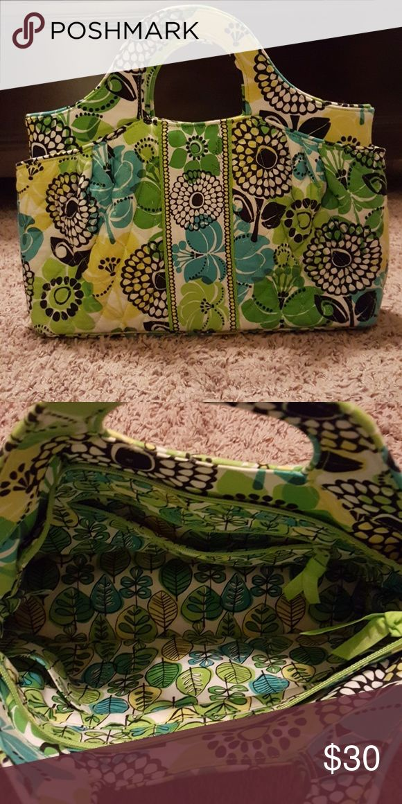 Vera Bradley Purse Vera Bradley handbag, I'm not sure the name of this one. I think the style may have been discontinued. It's a green, yellow, and blue floral print which was called Limes Up. It has two outer pockets on the corner, one zipper pocket on the inside, and three other pockets on the inside. I've used it a handful of time. Clean, no stains, never been put in the washing machine. Matching wallet is also in a listing. Vera Bradley Bags