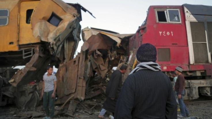 People gather at the scene of a train