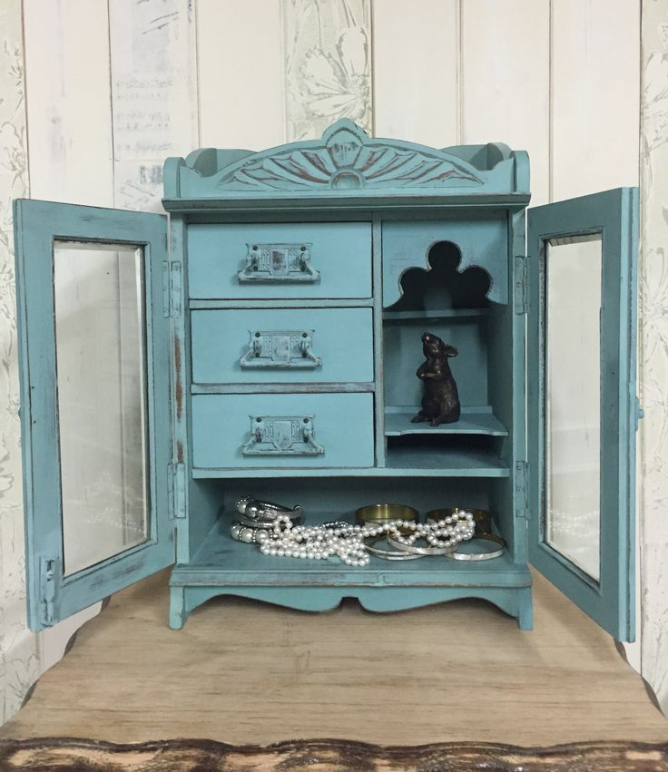 Jewellery armoire (formerly smoking pipe cabinet), painted in custom-mix shades of aqua  from the Annie Sloan Chalk Paint range, distressed, and sealed with soft clear wax.