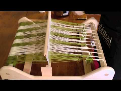 Warping and weaving on a rigid heddle loom.  I can't wait to try this!