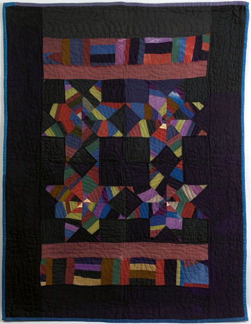 "Rare Amish wool crib quilt with pieced stars, blocks, and bars in various colors, 44 1/2"" x 34"". Pook & Pook auction house."