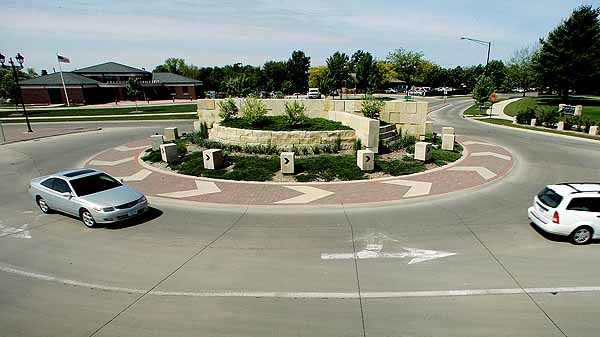This is a very simplistic design for a roundabout. It would be a cost effective design, providing the requirements of creating a safe alternative to the exiting roads. The basic gardens in the centre would be easy to maintain. However it's not unique or innovative, which I have an emphasis on being unique and doing something unusual.