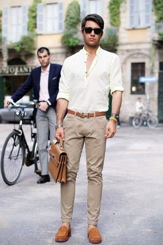 A beige henley shirt and beige pants feel perfectly suited for weekend activities of all kinds. Tan suede loafers will add elegance to an otherwise simple look.