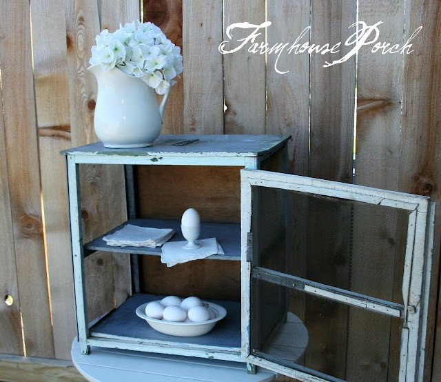 I have a large square pie safe.. replaced sides with glass, white & distressed minimally - use as liquor cabinet in DR