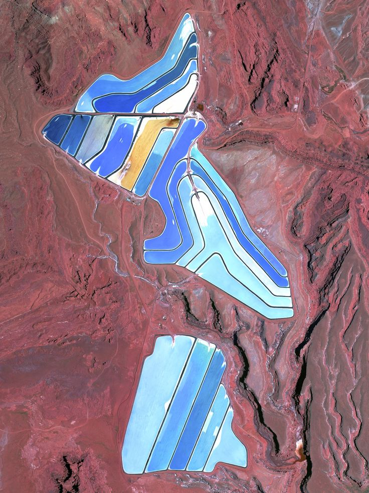 5/30/2015 Evaporation ponds of Intrepid Potash mine Moab, Utah, USA 38°29'0.16″N 109°40'52.80″W The Intrepid Potash Mine in Moab, Utah, USA produces muriate of potash, a potassium-containing salt used widely by farmers in fertilizer. The salt is pumped to the surface from underground deposits and dried in massive solar ponds that vibrantly extend across the landscape. As the water evaporates over the course of 300 days, the salts crystallize out. So why are you seeing such vibrant colors?…