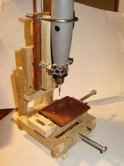 Micro Milling Machine by Technochicken -- Very small milling setup comprised of a rotary tool with flexible shaft and supported by a wooden frame. http://www.homemadetools.net/homemade-micro-milling-machine